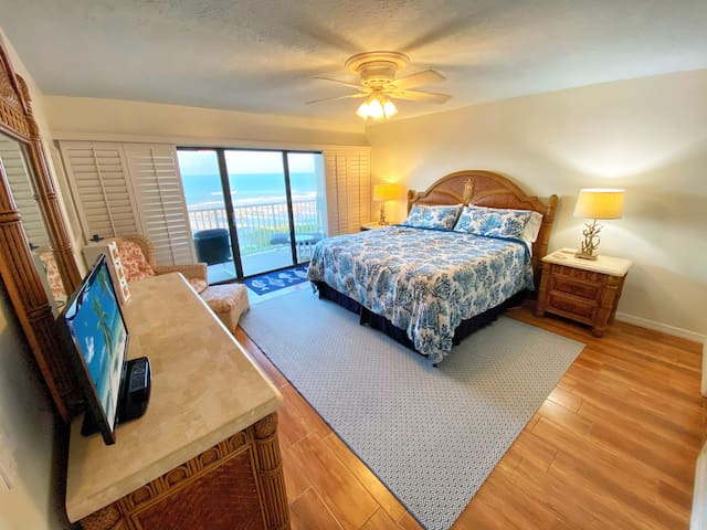 Wake up to the salty sunrise from your decadent king-sized bed in the Master Bedroom