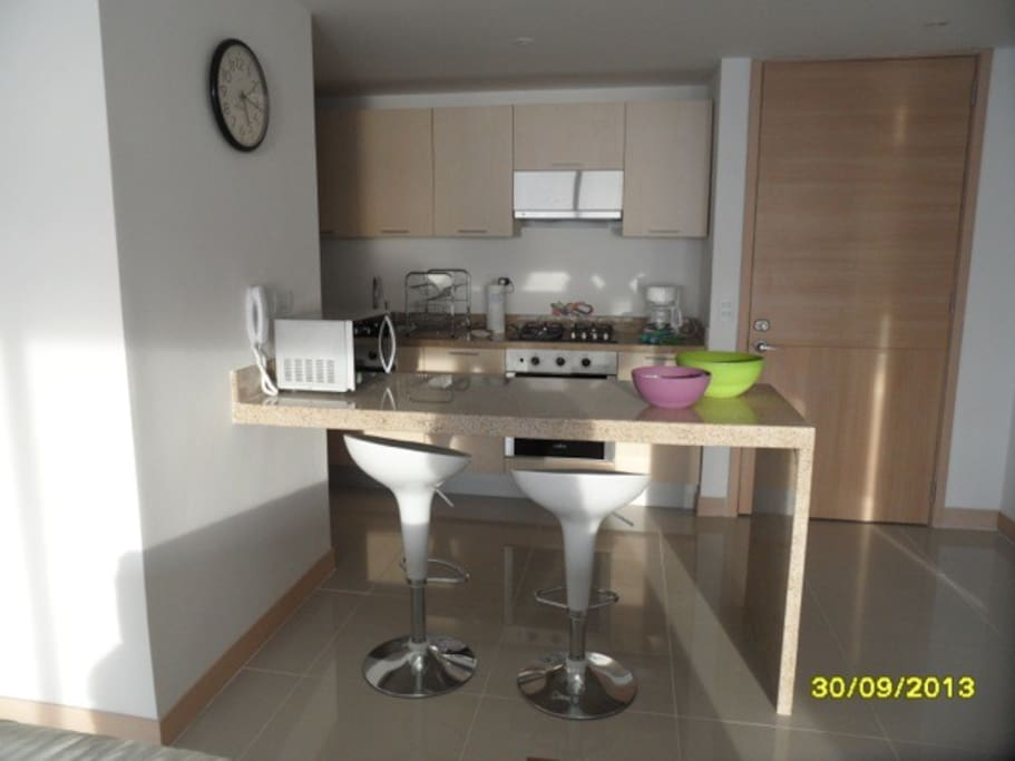 Fully equipped Kitchen with washing machine and dryer.