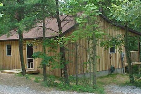 """The Nest Cabin"" at Hiding Place Cabins - Logan"