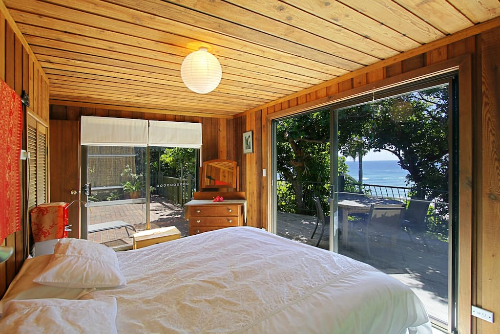 View from king size bed to beach