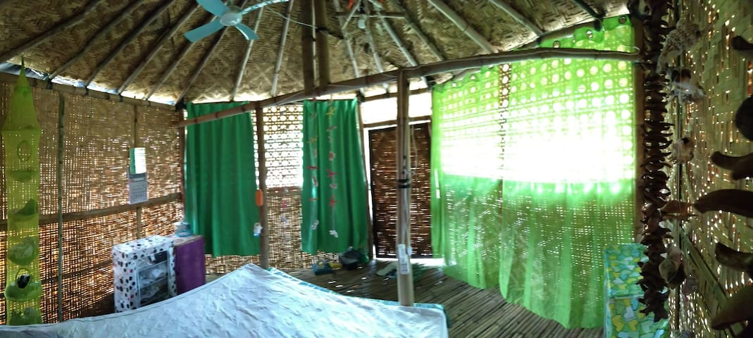 bungalow for two people made of natural materials, in particular bamboo, the bungalow has a safe for things that close, a closet for things, a mosquito net, gas cylinders you can cook,bungalow size 16 square meters