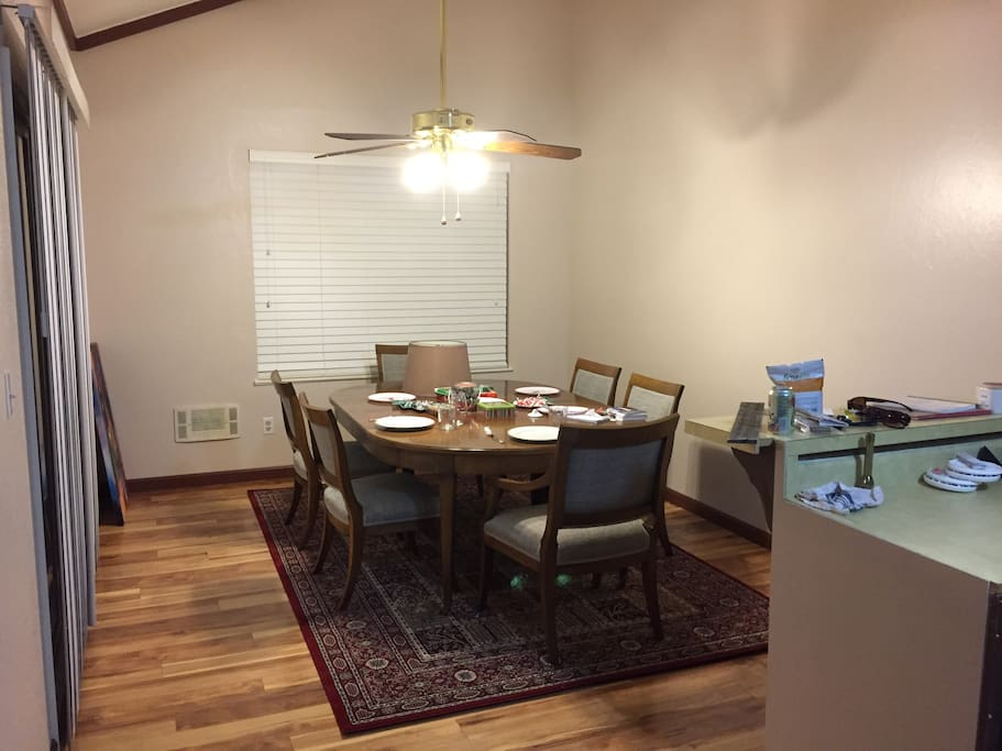 Walnut dining table with 3 leaves and 8 chairs. Views of the lake from the table.