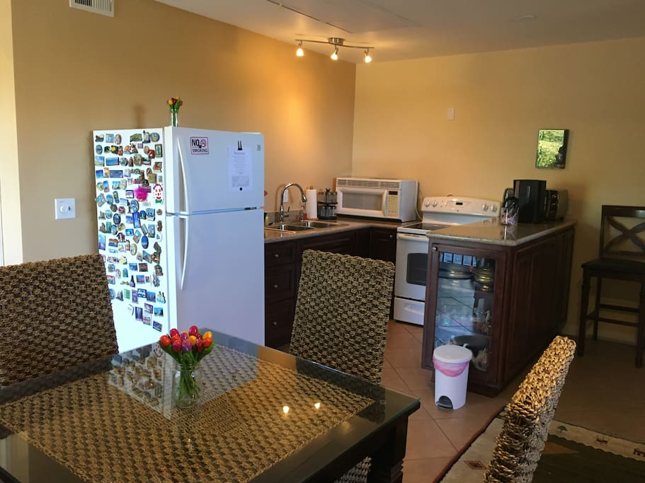 Kitchen, coffee maker, refridgerator, oven stove, conventional oven and microwave.