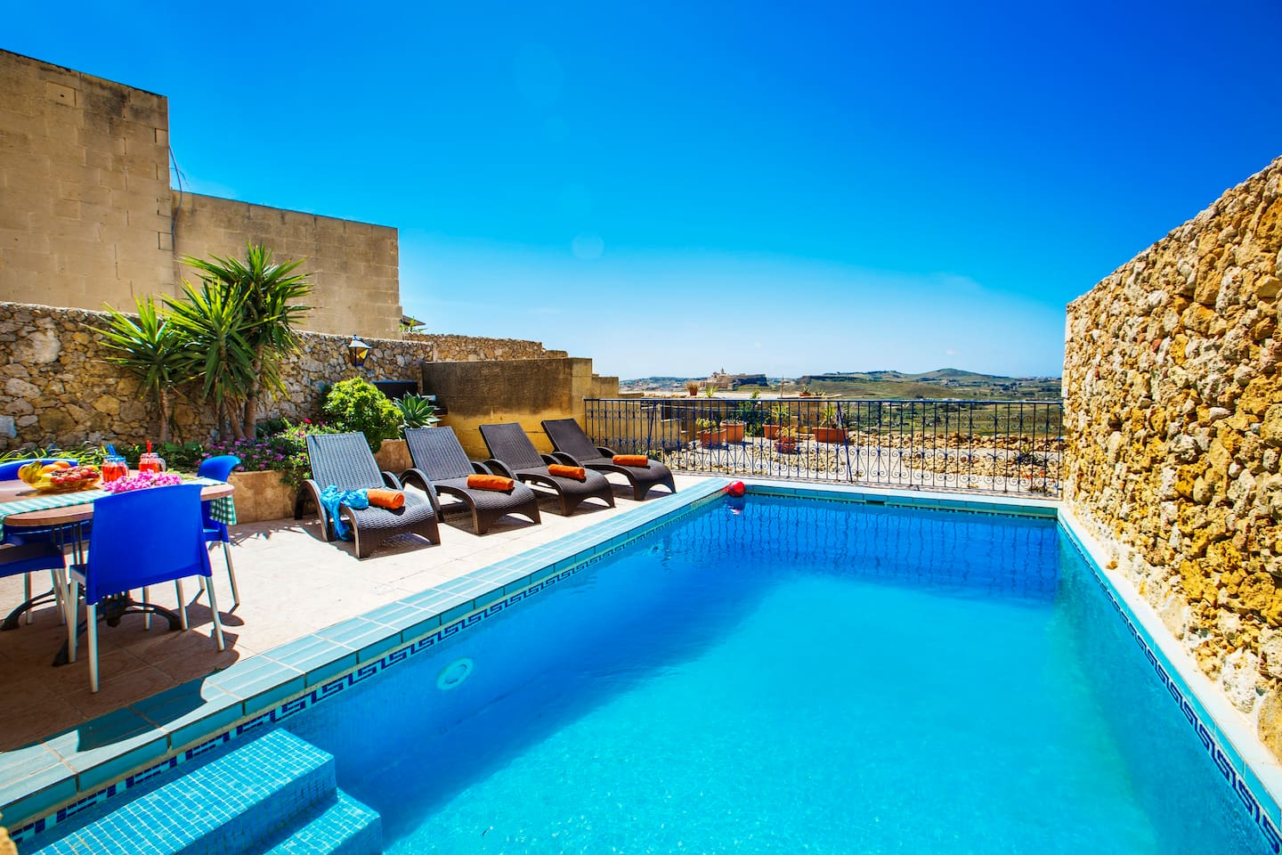 Sunny pool terrace with wonderful countryside views