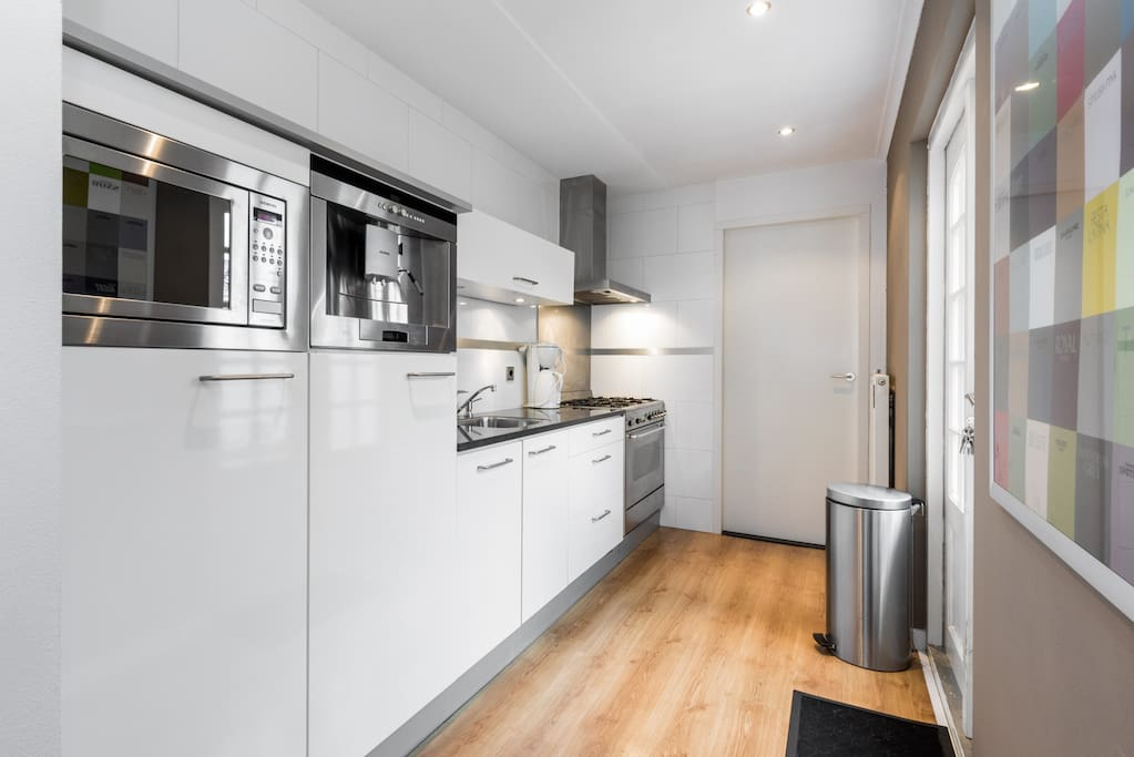 Modern kitchen with microwave, grill, huge oven, 5 pits cooking, a delicious coffee machine and garden doors wich brings you to the romantic place outside.