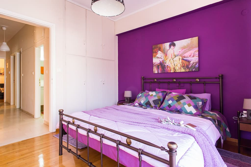The purple bedroom from anothe view.