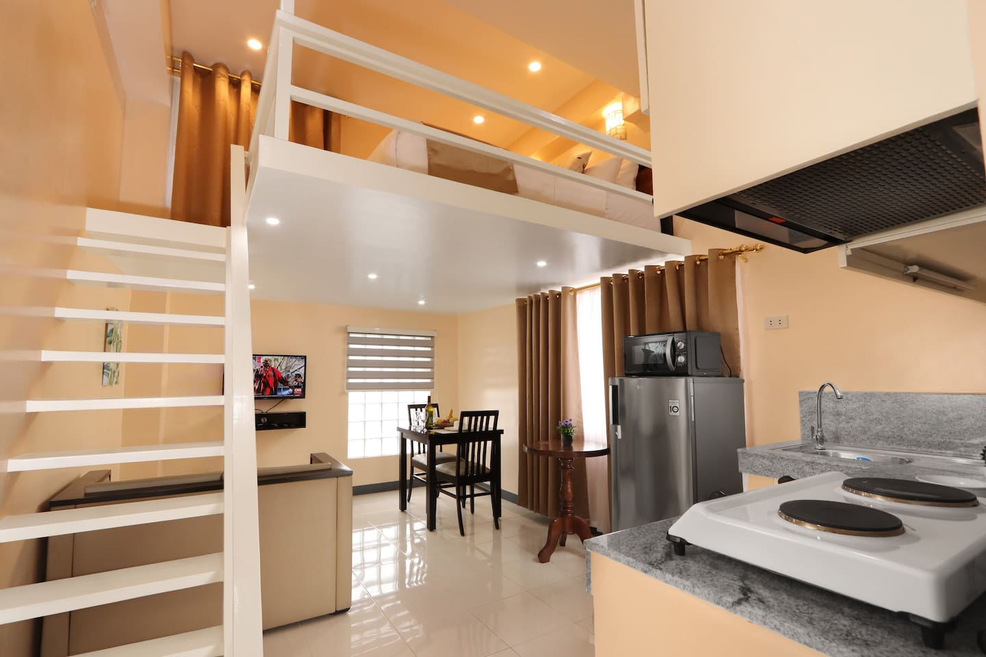 Rosetta Guest House Executive room is equipped with Refrigerator, Microwave Oven, Electric Cooker, Rice Cooker, Dining Essentials and Split Type AC.