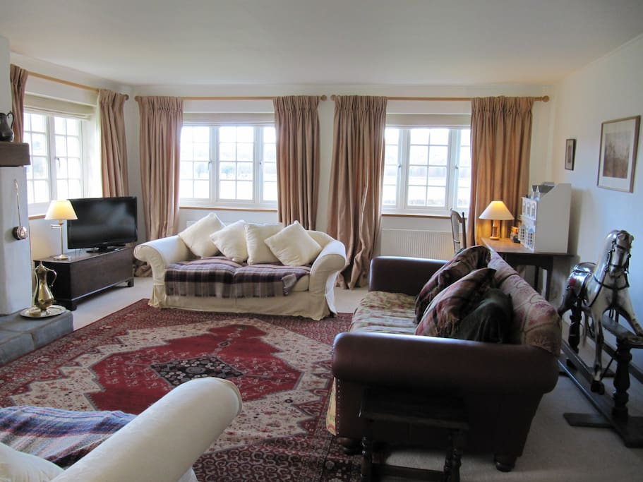 living room with views all round to the fells and w comfy sofas