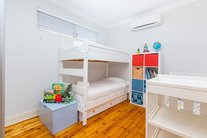 Bedroom 3 - the kids bedroom! Complete with bunk bed (single over single, cot, baby change table & robe for your belongings.