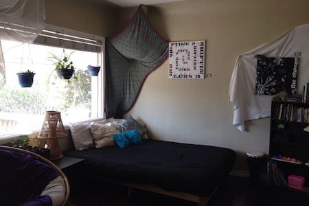 Futon in living room of AuroraHouse - Edmonton