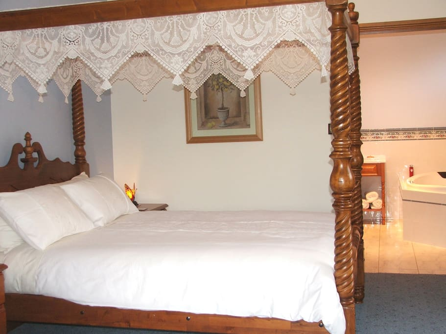Solid timber four poster with dual access to the spa bathroom. Very Comfortable beds