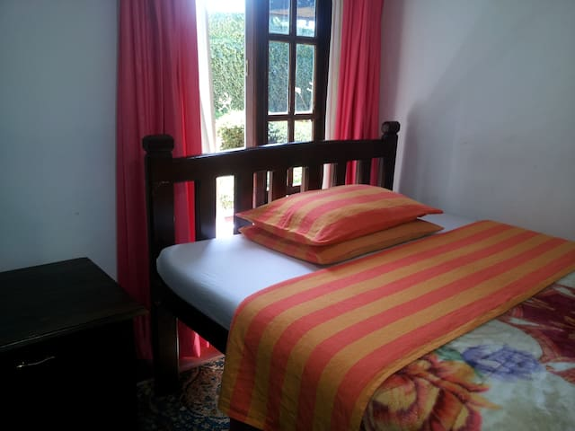 Room No.3 with one double bed with a private tiled bathroom with hot water shower.