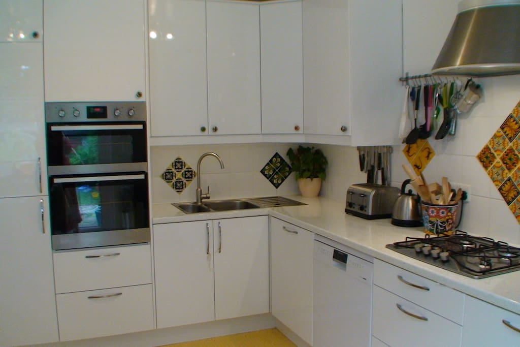The kitchen has and intergrated double oven, microwave and dishwasher