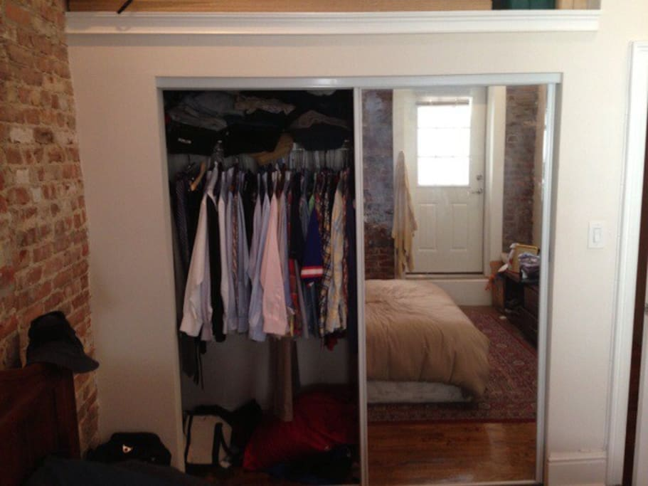 Large closet space with overhead storage