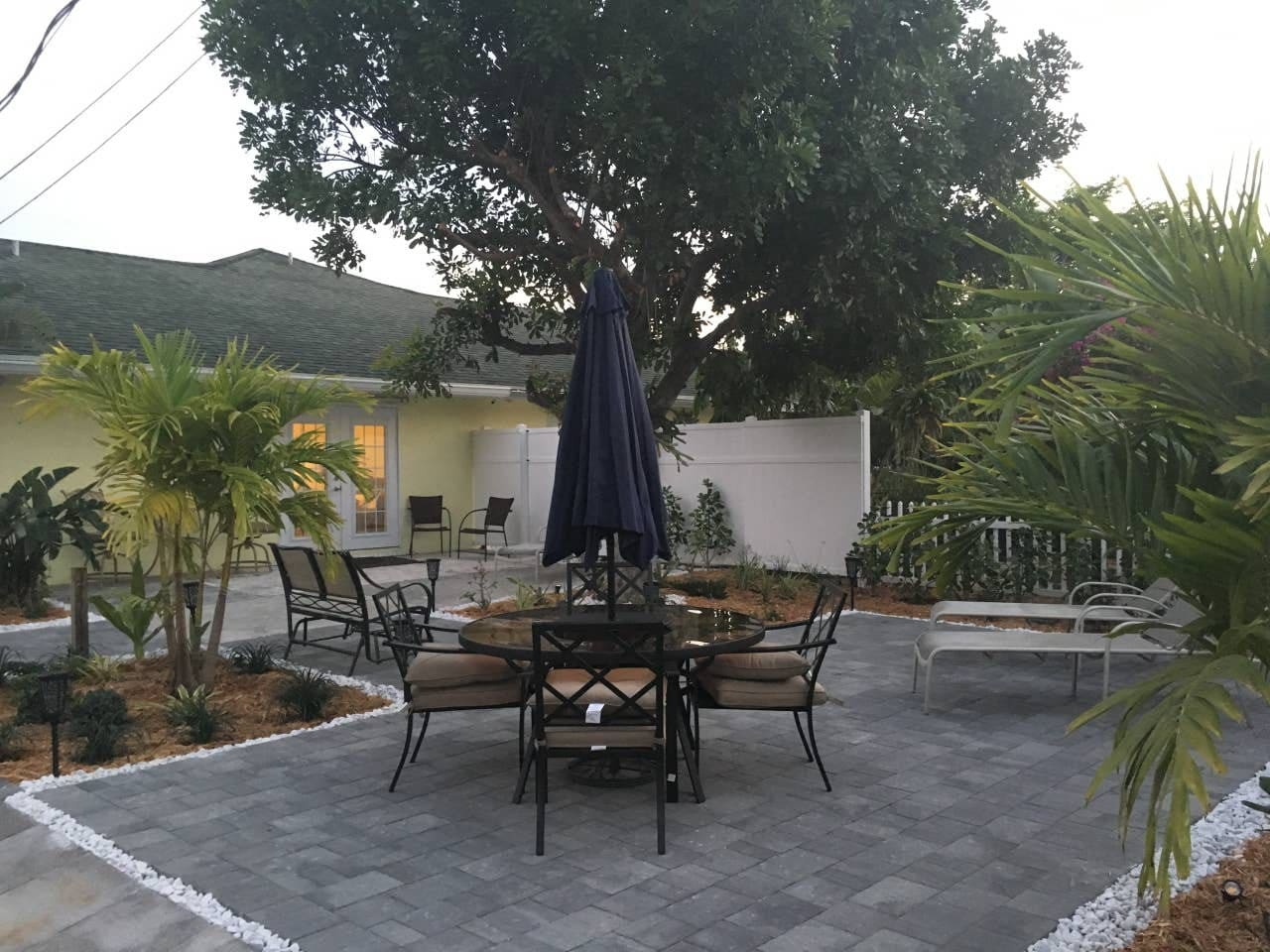 The backyard is perfect for soaking up the sun, reading and relaxing under a tree, or meal time with your party as you take in Florida's natural beauty! Evening time is even more magical as the mood lighting comes on and the night sky takes over.