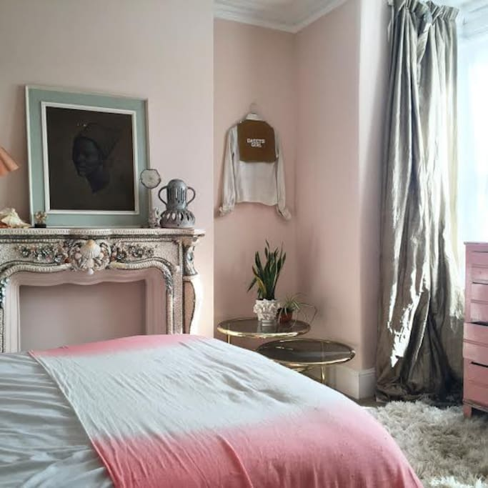 Pink fluffy walled double bedroom