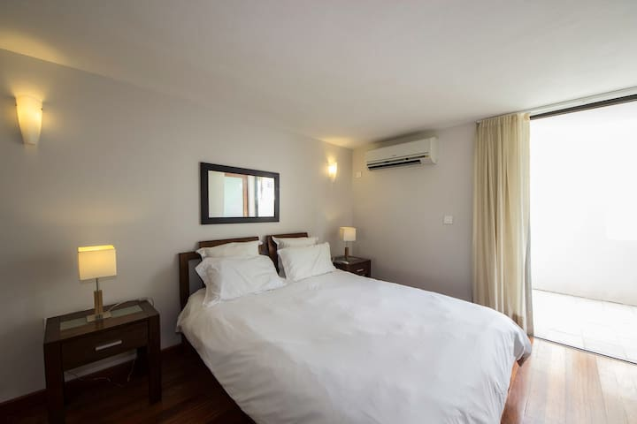 King Size Bed with Patio doors that open to the rear Patio. You have modern Air Con in the bedroom.