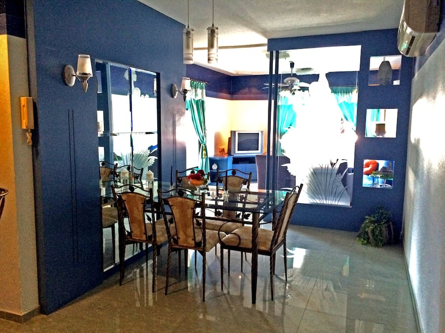 Dining area leading to living room - Classy and modern!