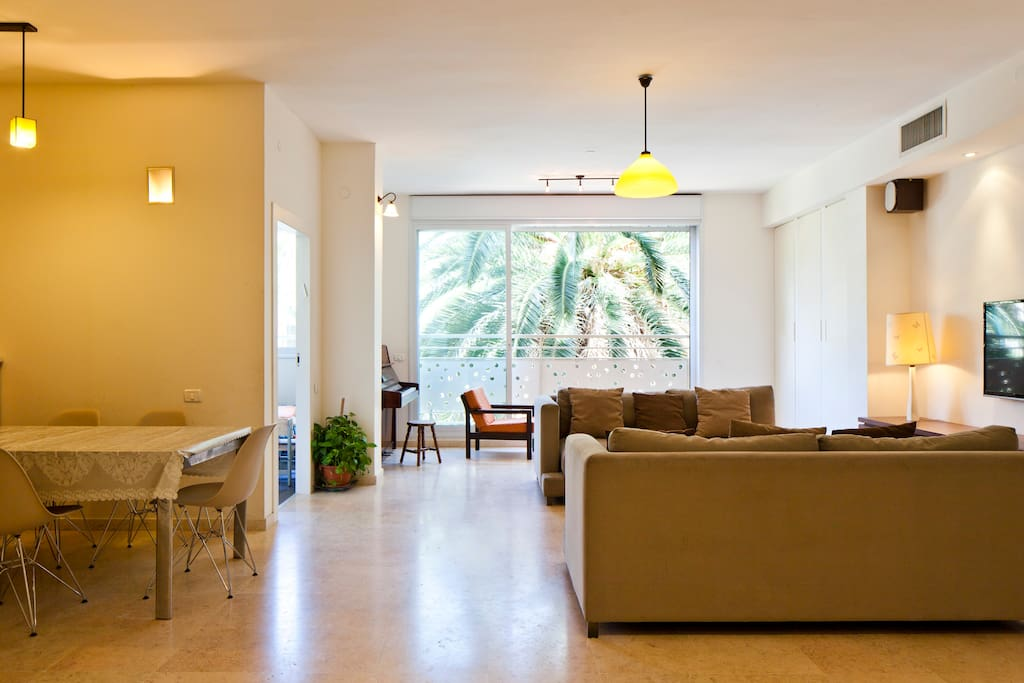40sm living room with an open kitchen and green view