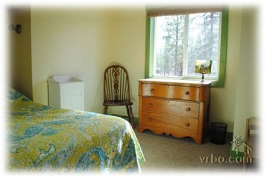 One of 2 bedrooms, both rooms have queen-sized beds and dressers