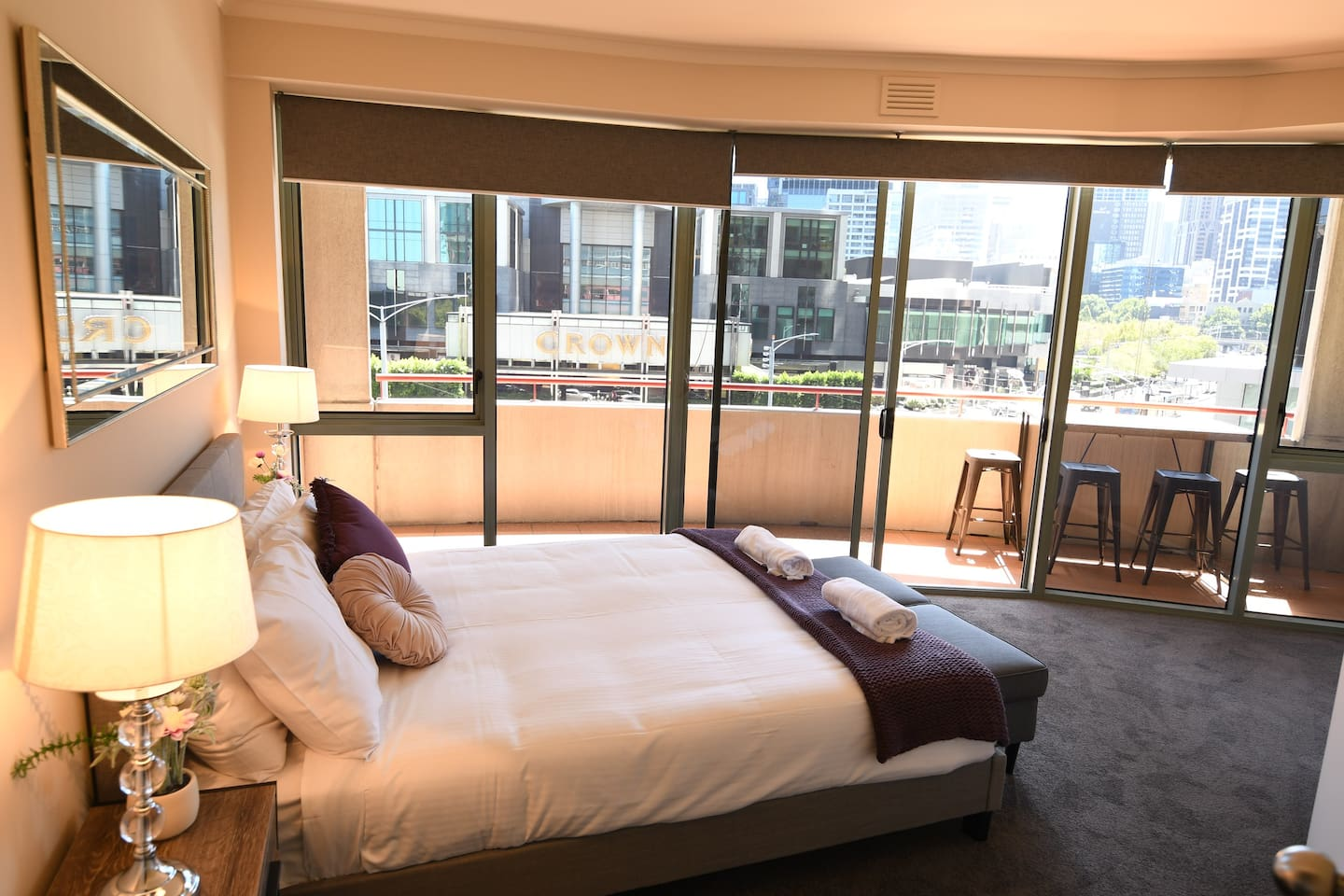 Queen bed with laege private balcony overlooking the Crown Casino