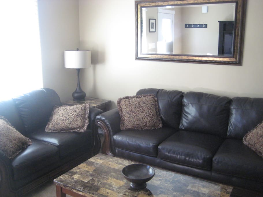 comfortable leather couches make the living area inviting