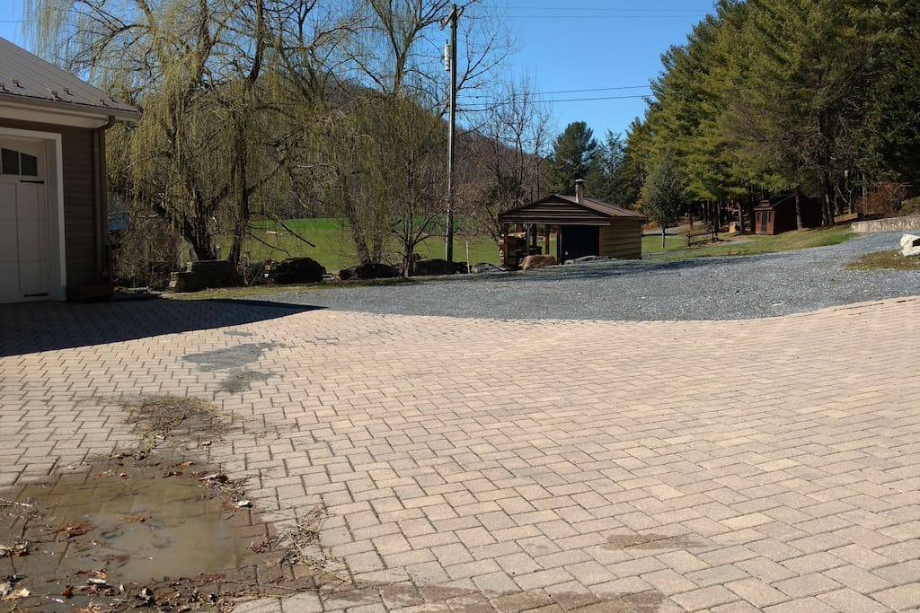 paver driveway and gravel parking area