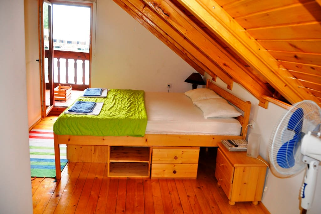 Spacious master bedroom with a balcony access.
