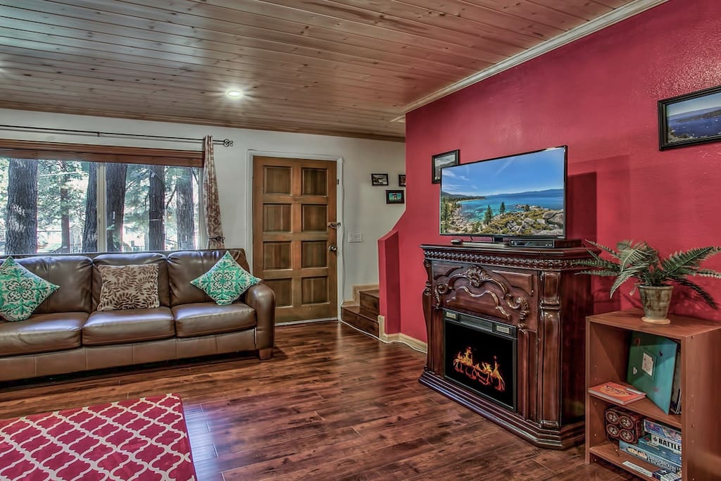 Living room - big screen tv w/ cable & fast wifi, a decorative electric fire  place, board games & etc.