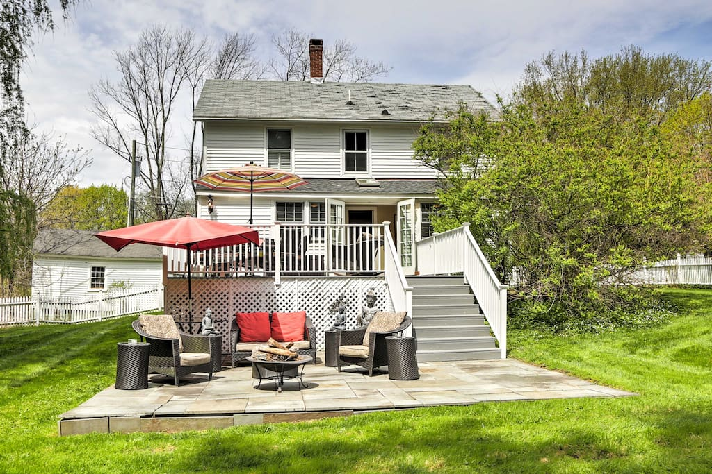 'Stone-Peca' is a quintessential New England property that sits on a half acre of land and offers a spacious backyard with a deck and patio.