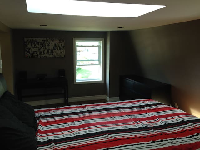 3rd floor is open concept with bedroom leading into office