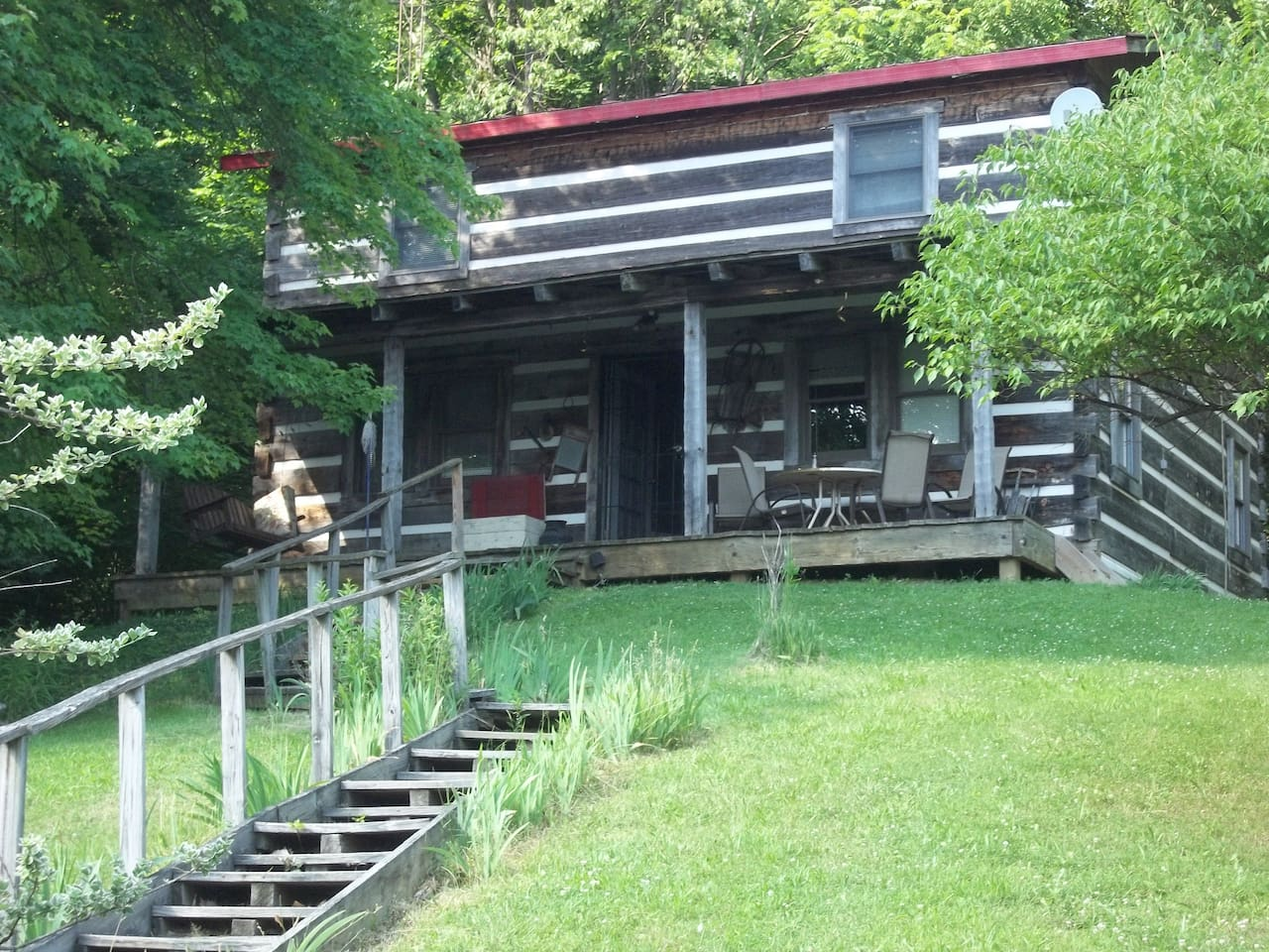 Welcome to Hilltop Hide-A-Way log home - a great place to relax and enjoy nature.