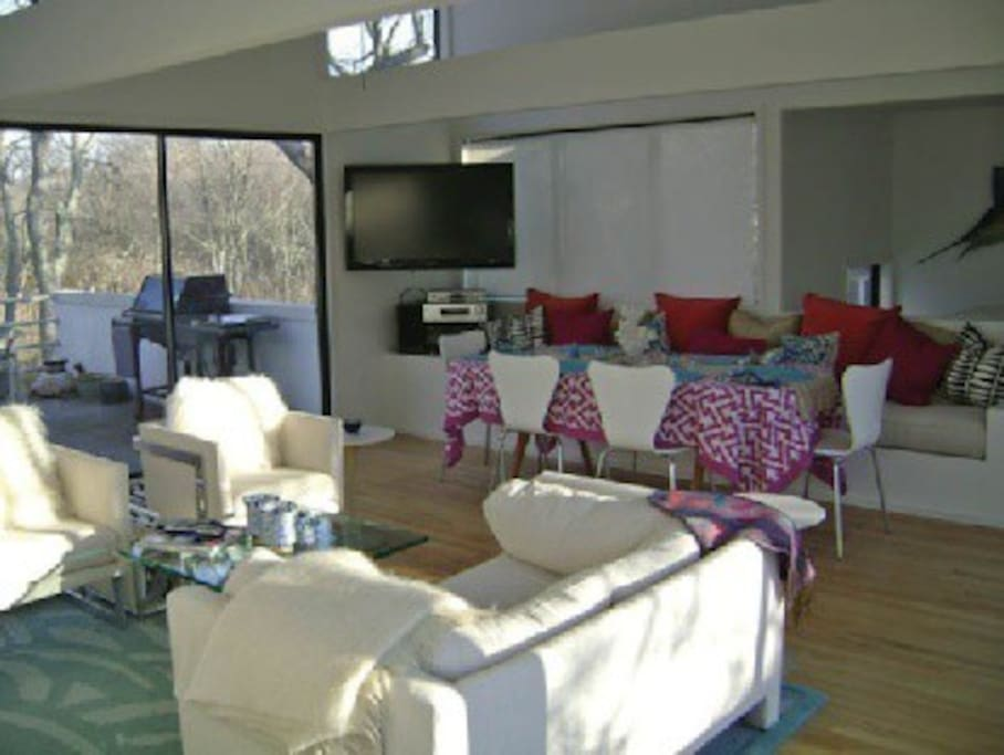 living room/dining room area and upstairs deck with weber grill