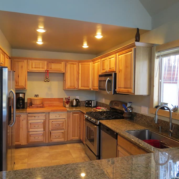 Remodeled kitchen, granite counters, part of the open great room
