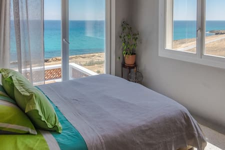 Room with terrace overlooking sea