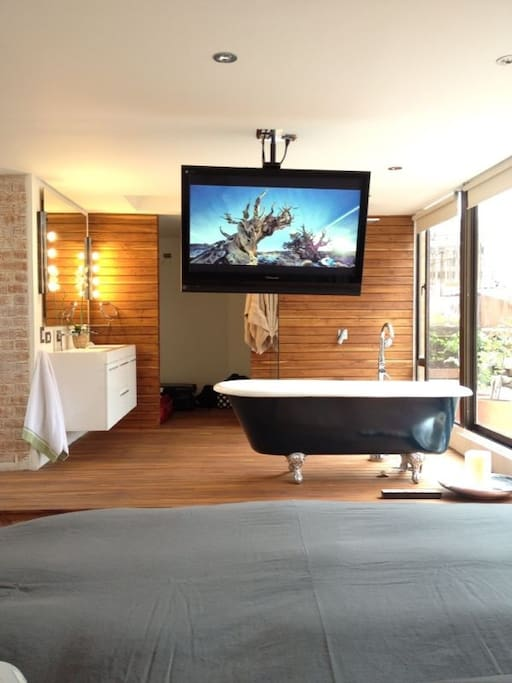 Amazing bathtub in the open wooden bathroom in the master suite