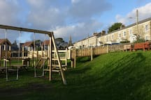 Play area with Lantern cottage at the far end of this beautiful row of listed houses
