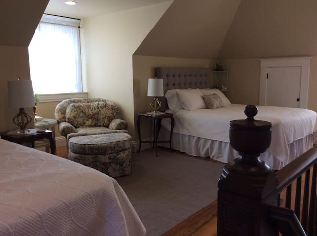 Two queen beds share this space