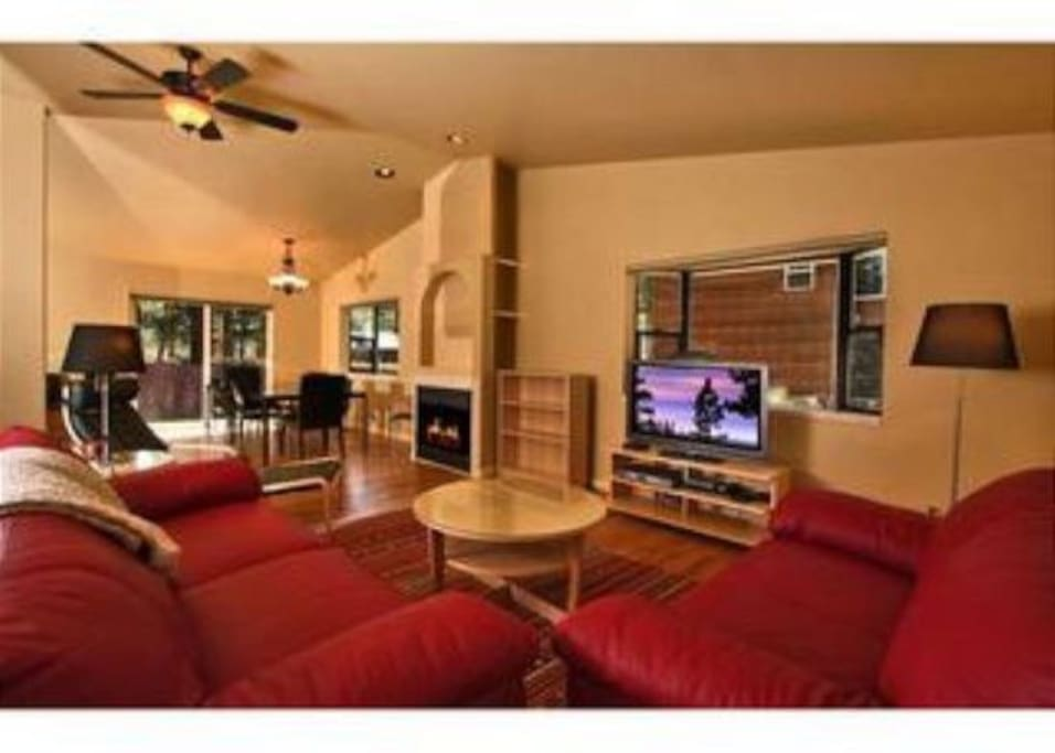 Living room with fireplace and plasma TV