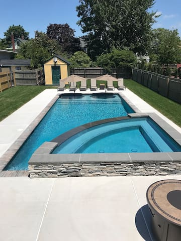 New large heated pool (40 x 16 feet) with sundeck and large hot tub.
