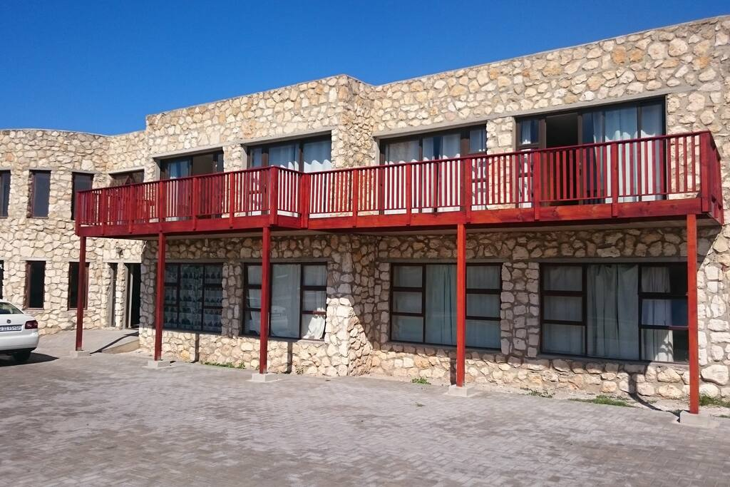 Stonehouse is the ideal place to stay for extended visits or overnight during your travels. Stonehouse is 5min walk to the main swimming beach in Struisbaai and easy accessible. It is a great place to stay for couples, solo adventurers, business travellers and a families. Lots of parking is included.