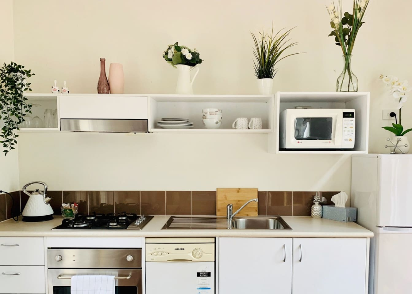 Fully Equipped kitchen with Bianco gas stove, electric oven, dishwasher, microwave and all cooking utensils and equipment, as well as basic cooking oil & Seasonings!
