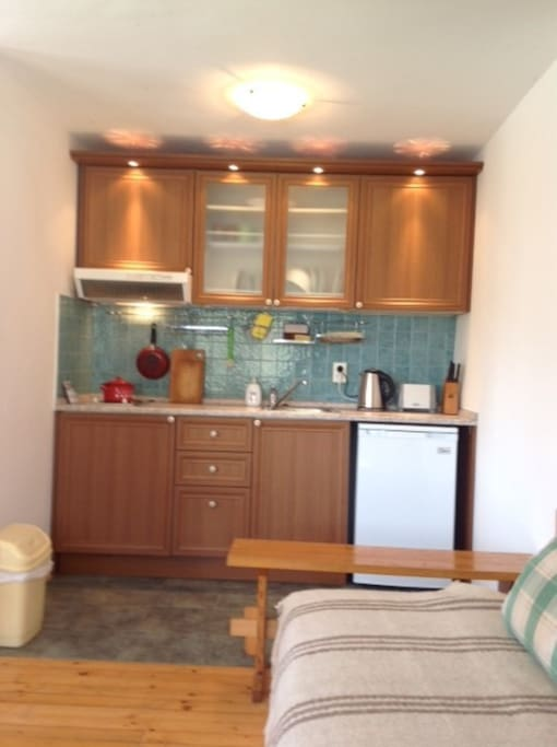 Kitchenette has stove, fridge, toaster and kettle. If you're a baker, you're welcome to use the oven upstairs!