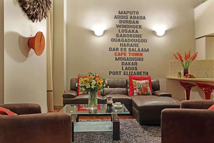 AfriNest Lounge with it's international wall