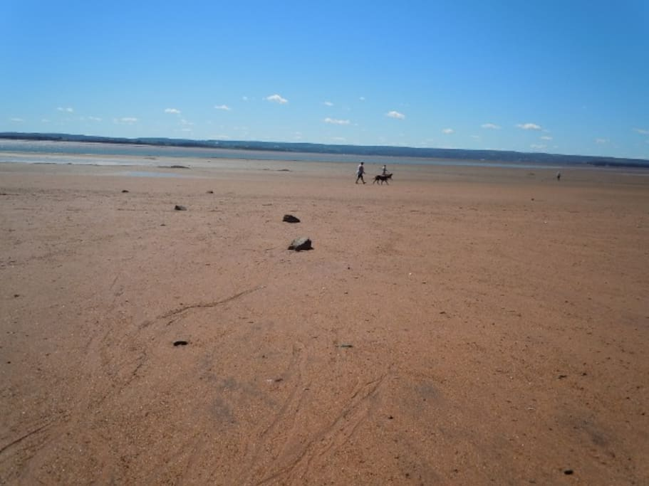 Walkable sandy beach.  Swimming when tide is in.
