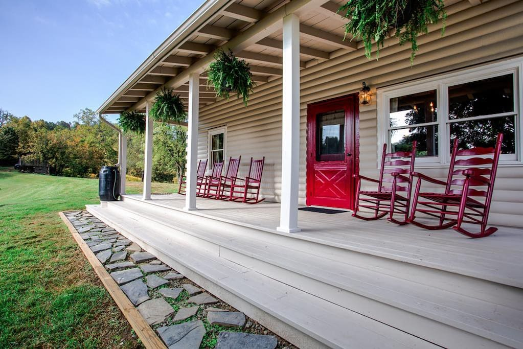 A covered porch with plenty of seating