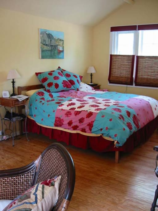 The master bedroom has a kingsize bed, sitting area and ensuite bathroom.