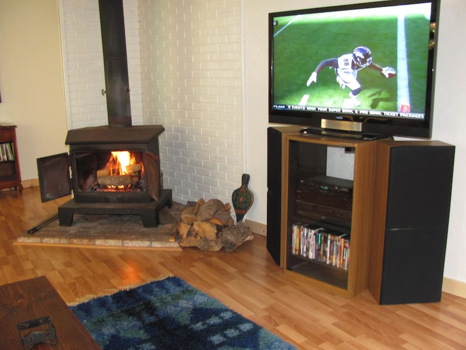 The wood burning stove offers additional heat and great cozy ambiance.