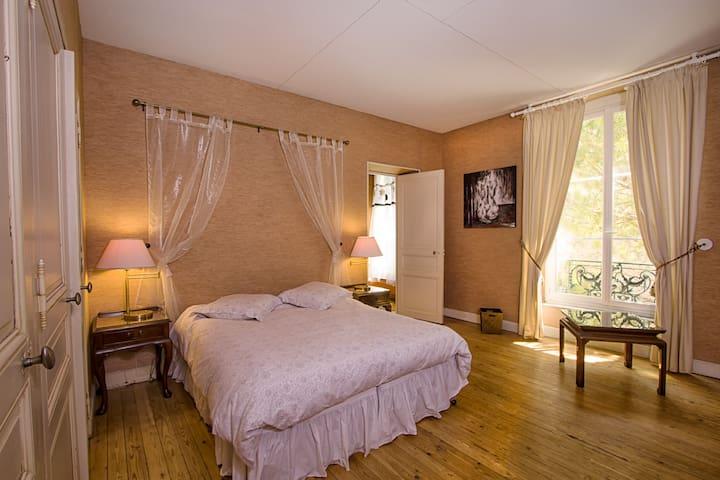 Spacious master bedroom has a garden view. Queen bed can convert to 2 single beds.