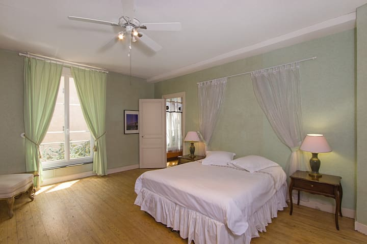 Largest green bedroom also has a garden view, reading chair, and fireplace. It can be configured with three single beds or one single bed plus a queen (160cm) bed.